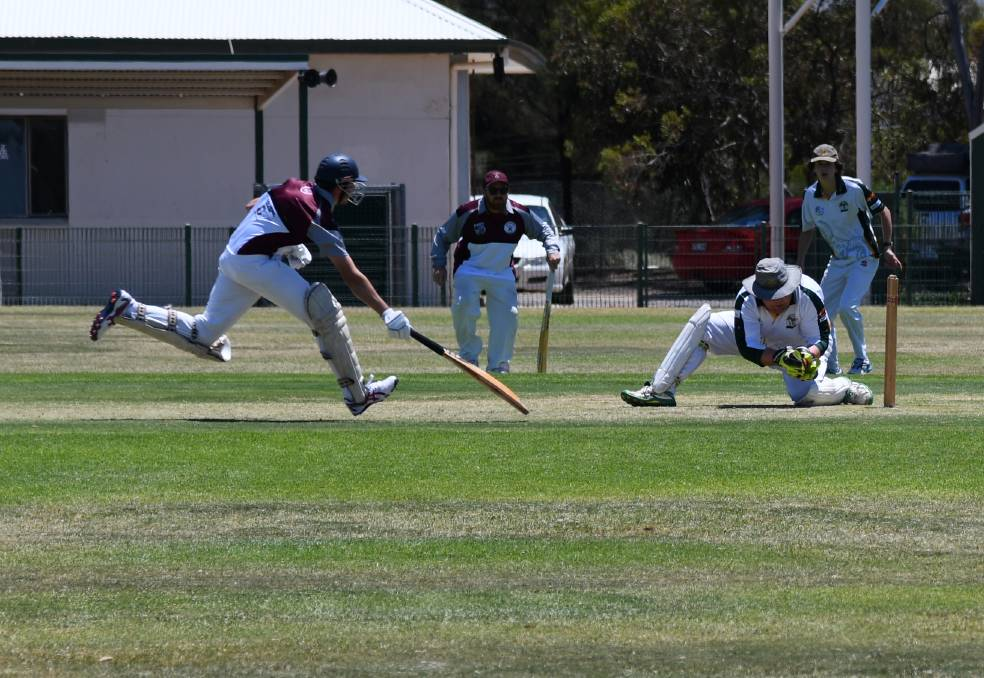 TENSE: Olly Cosmai races home as keeper Matt O'Shaughnessy races to run him out. In the background is umpire James Congdon holding the bat and Wandearah fielderJack Soutar.